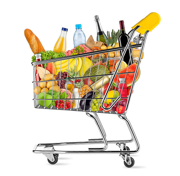 isolated shopping cart filled with food yellow shopping cart filled with various food and beverages isolated on white background full stock pictures, royalty-free photos & images
