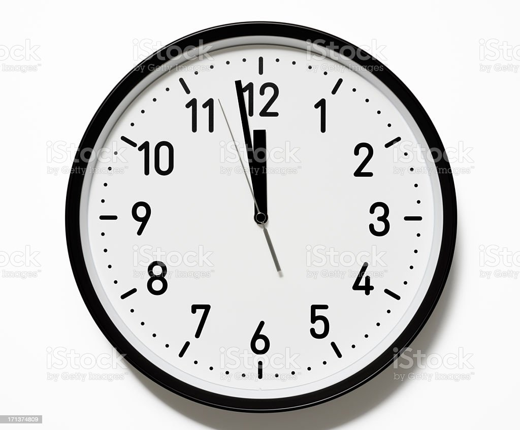 Isolated shot of 12 O'Clock clock face on white background stock photo