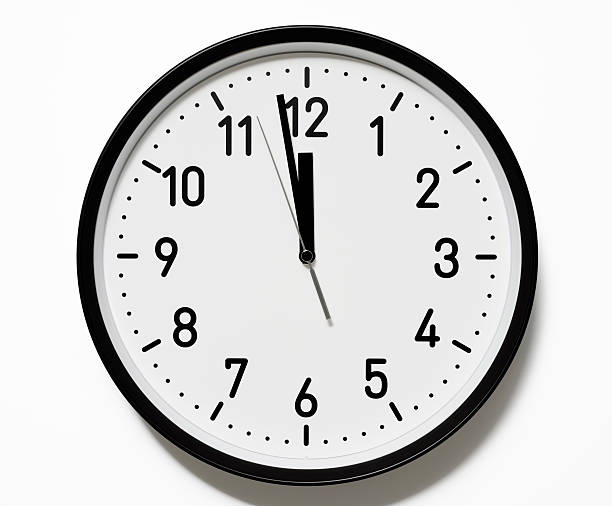 Isolated shot of 12 O'Clock clock face on white background With CLIPPING PATH.Clock face isolated on a white background with clipping path.Studio shot. midnight stock pictures, royalty-free photos & images
