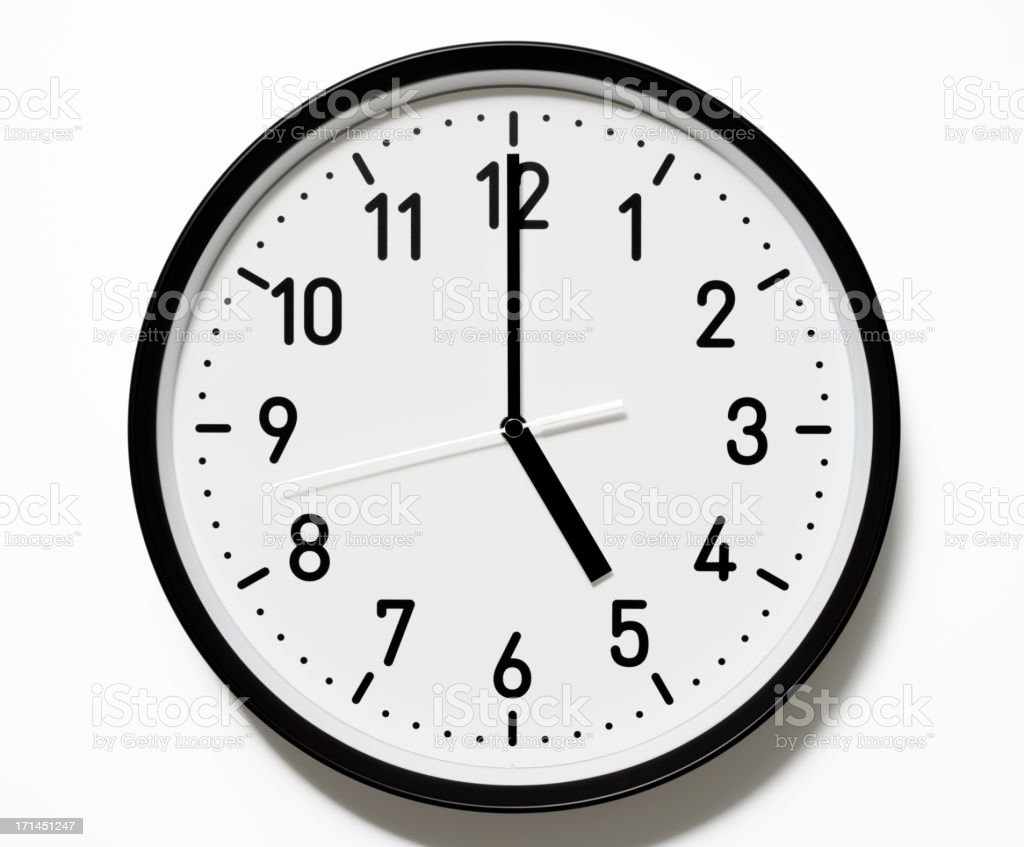 Isolated shot of 5 O'Clock clock face on white background stock photo