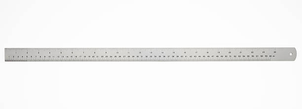 isolated shot of 60 cm metal ruler on white background - ruler stock photos and pictures