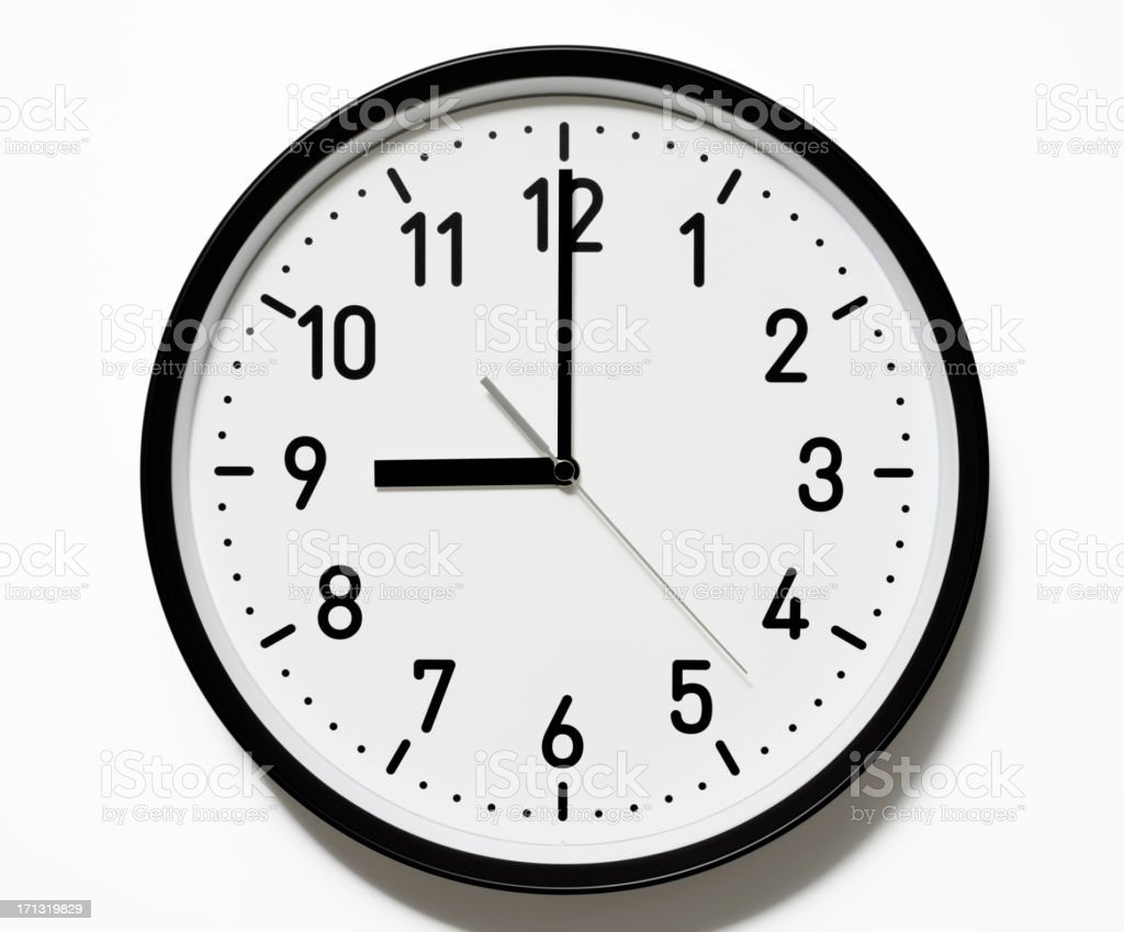 Isolated shot of 9 O'Clock clock face on white background stock photo