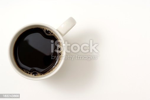 Overhead shot of a cup of coffee isolated on white background with soft shadow.