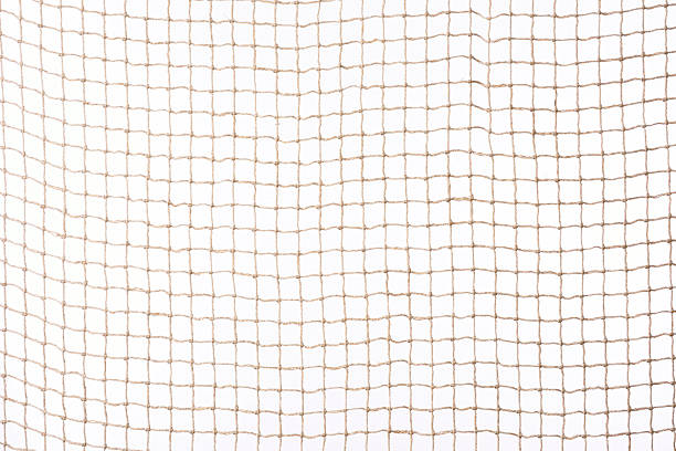 Isolated shot of beige netting against white background Beige netting isolated on white background. fishing net stock pictures, royalty-free photos & images