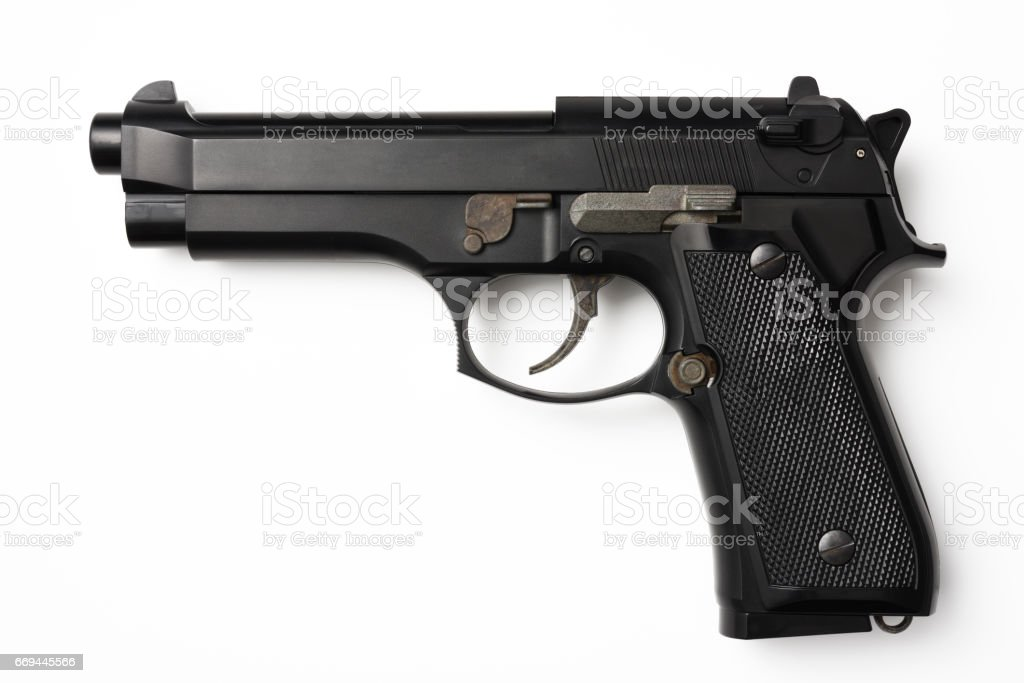 Isolated shot of black pistol on white background stock photo