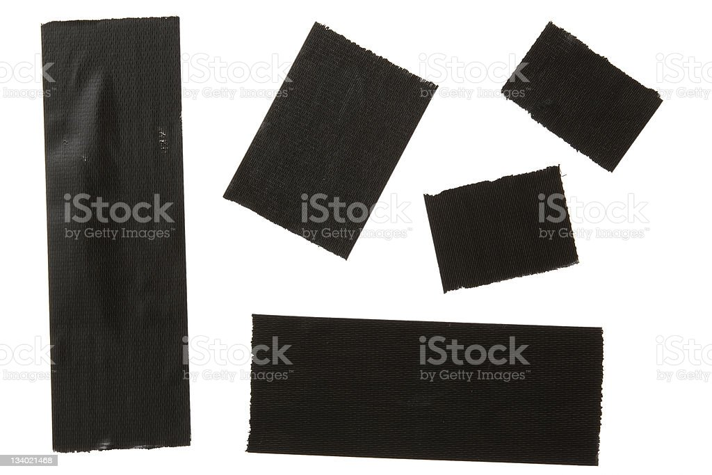 Isolated shot of black torn duct tape on white background stock photo