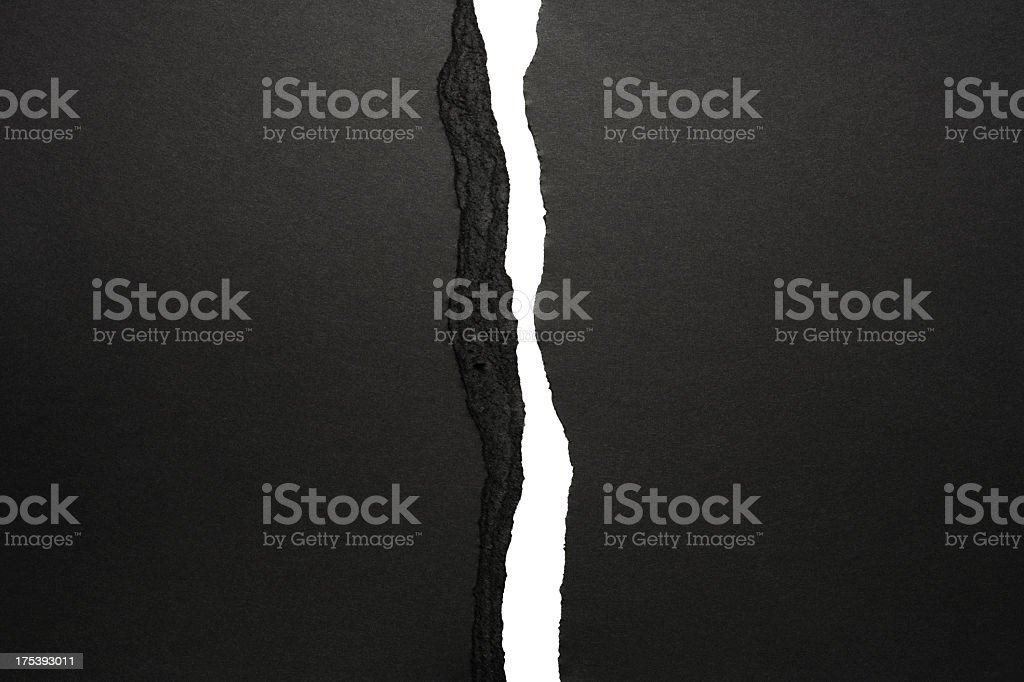 Isolated shot of black torn paper border on white background stock photo