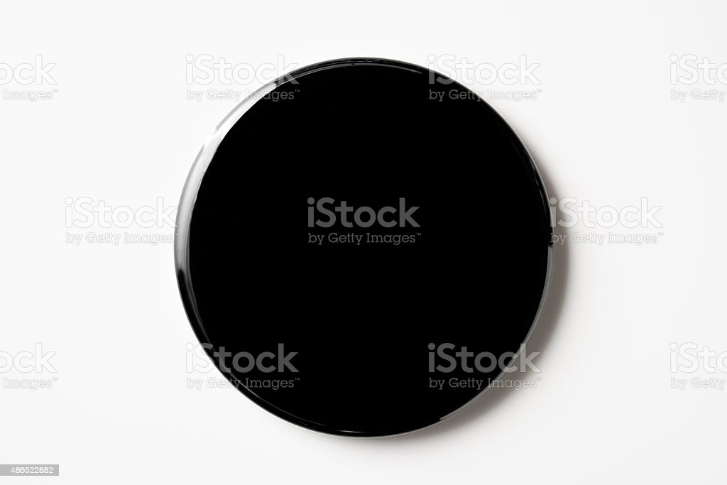 Isolated shot of blank black badge on white background stock photo