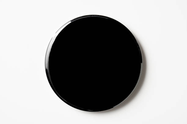 Isolated shot of blank black badge on white background stock photo