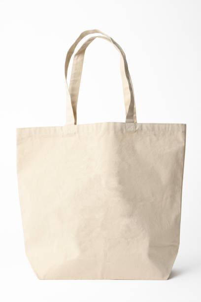 Isolated shot of blank canvas tote bag on white background stock photo