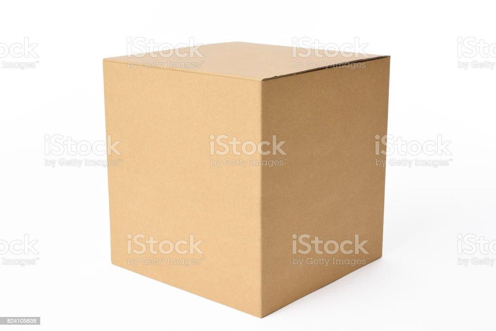 Isolated shot of blank cube cardboard box on white background stock photo