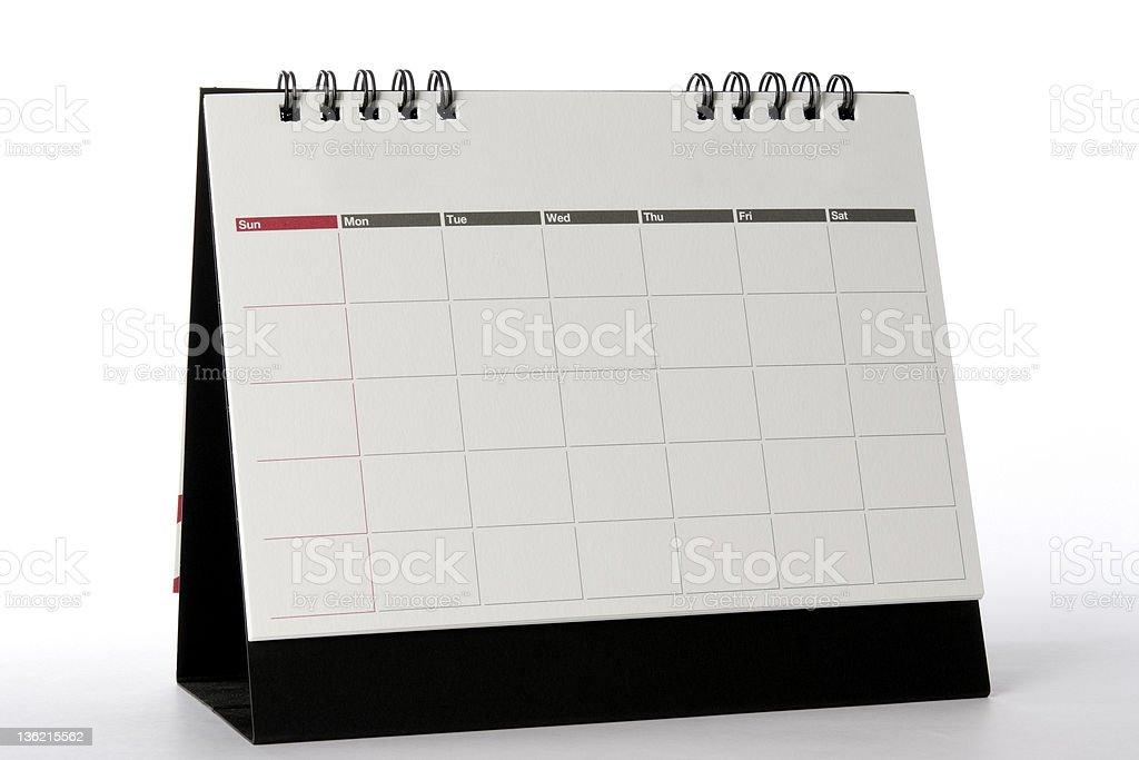 Isolated shot of blank desktop calendar on white background royalty-free stock photo