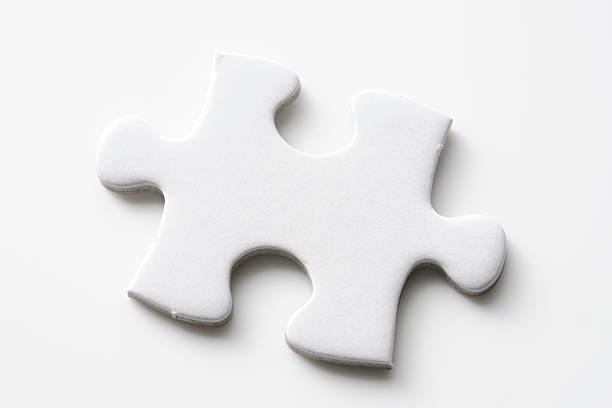 Isolated shot of blank jigsaw puzzles piece on white background stock photo
