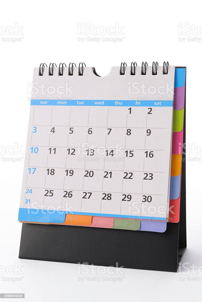 Isolated shot of blank multicolored desktop calendar on white background stock photo