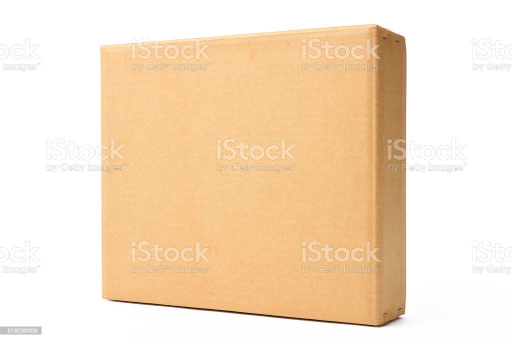 Isolated shot of blank old cardboard box on white background stock photo