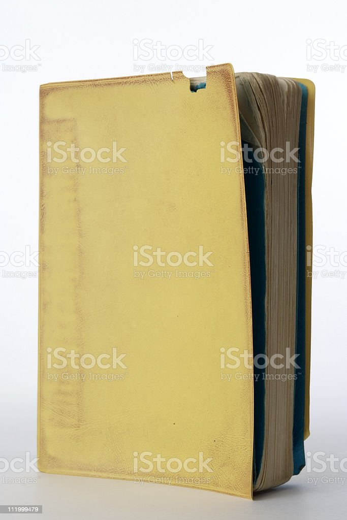 Isolated shot of blank old yellow book on white background royalty-free stock photo