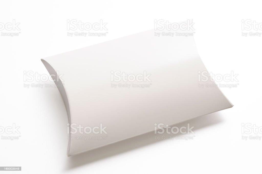 Isolated shot of blank pillow shape box on white background royalty-free stock photo