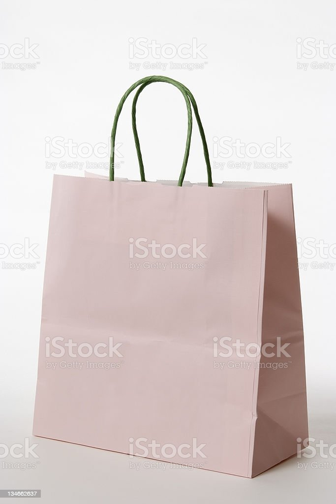 Isolated shot of blank pink shopping bag on white background royalty-free stock photo