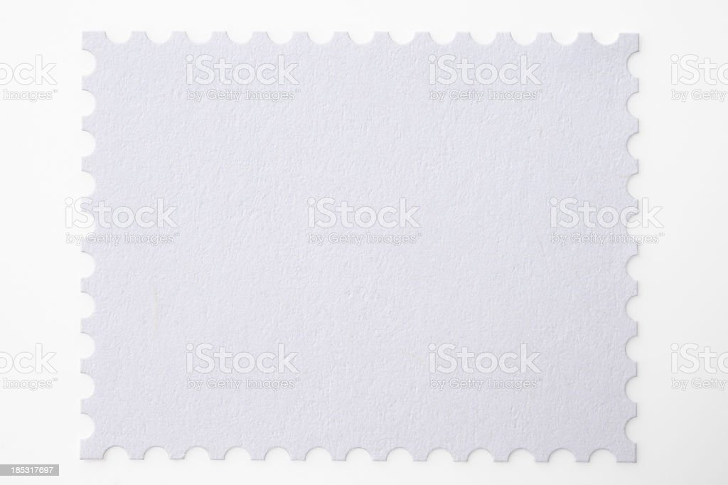 Isolated shot of blank postage stamp on white background stock photo