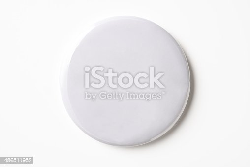 Overhead shot of blank white badge isolated on white background with clipping path.