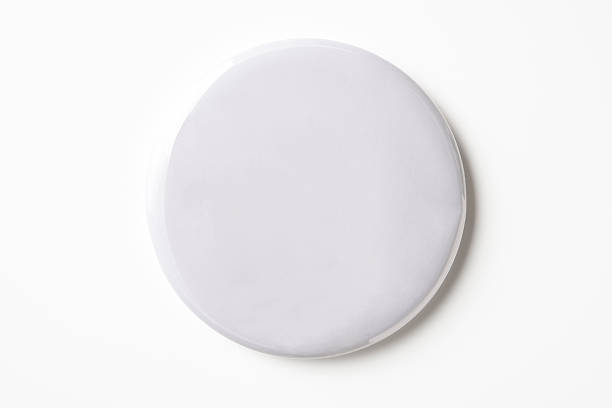 isolated shot of blank white badge on white background - button stock photos and pictures