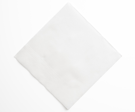 High angle view of blank white paper napkin isolated on white background with clipping path.