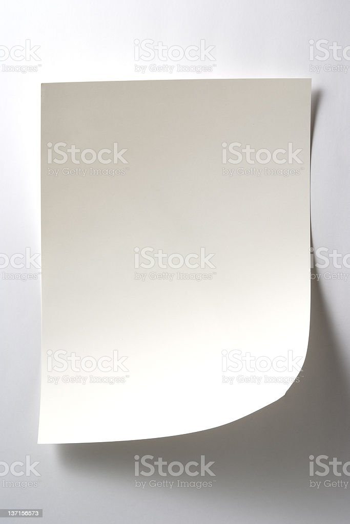 Isolated shot of blank white paper on white background royalty-free stock photo