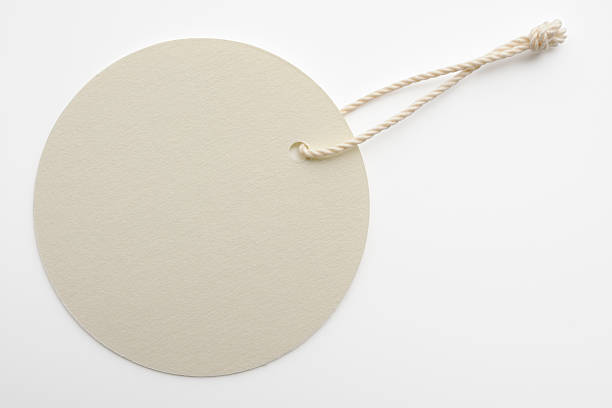 Isolated shot of blank white round tag on white background stock photo