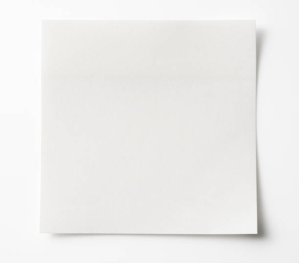 isolated shot of blank white sticky note on white background. - curled up stock pictures, royalty-free photos & images