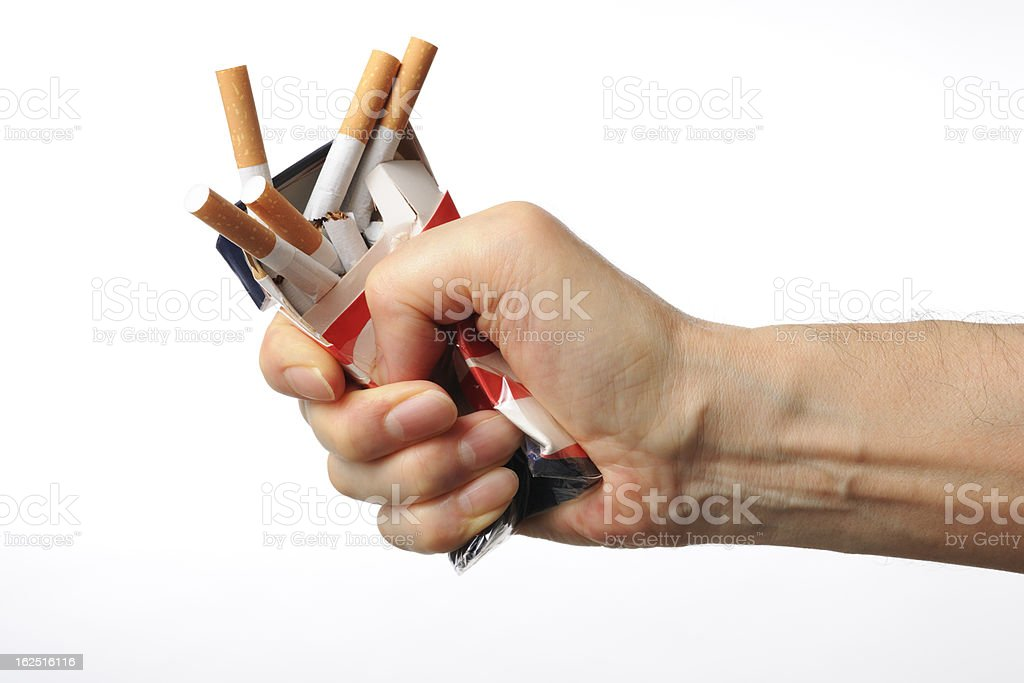 Isolated shot of broken cigarettes on white background royalty-free stock photo