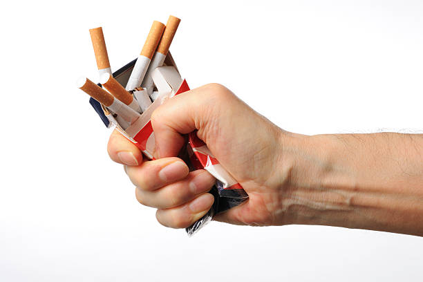 Isolated shot of broken cigarettes on white background stock photo