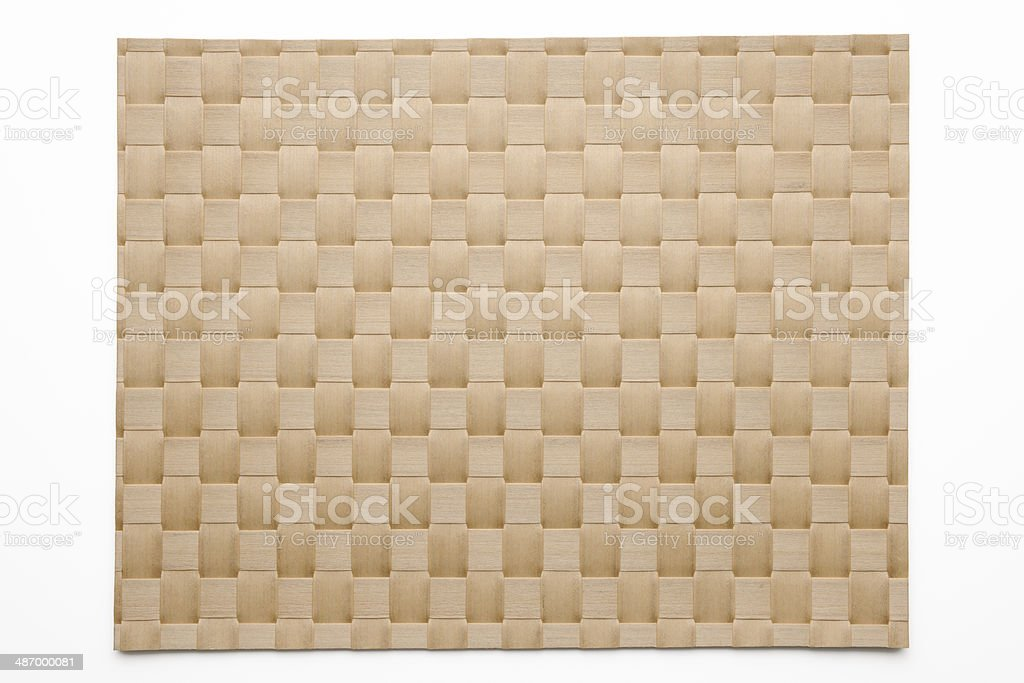 Isolated shot of brown bamboo place mat on white background stock photo