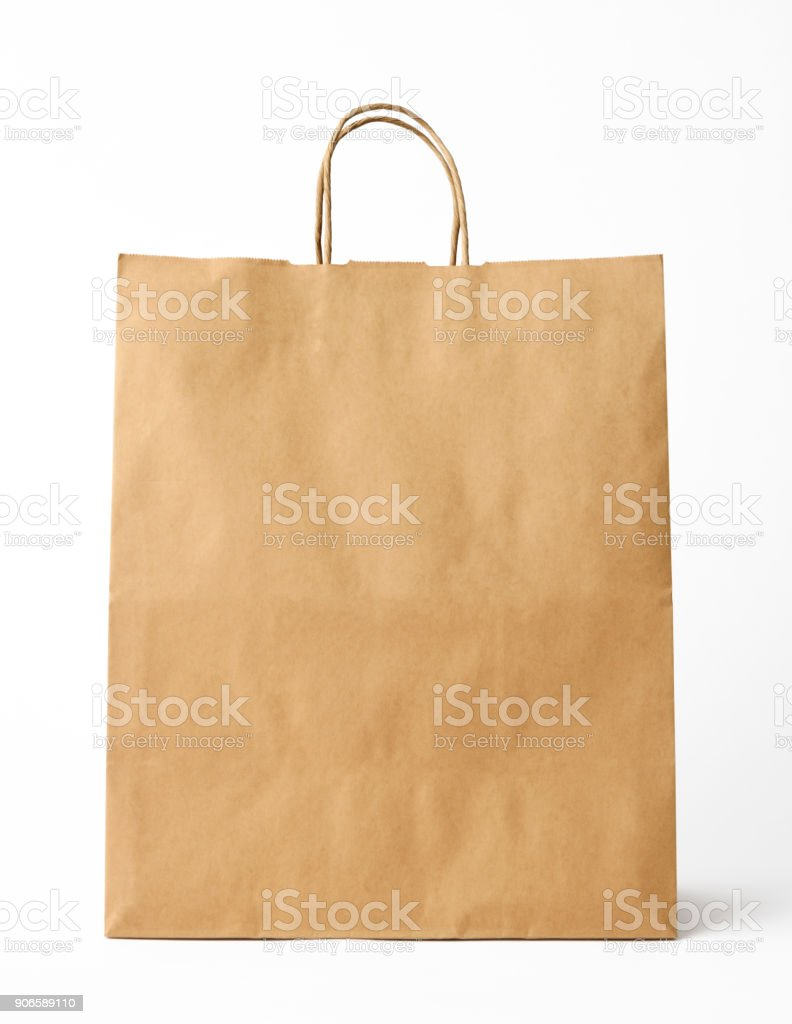 Isolated shot of brown paper shopping bag on white background stock photo