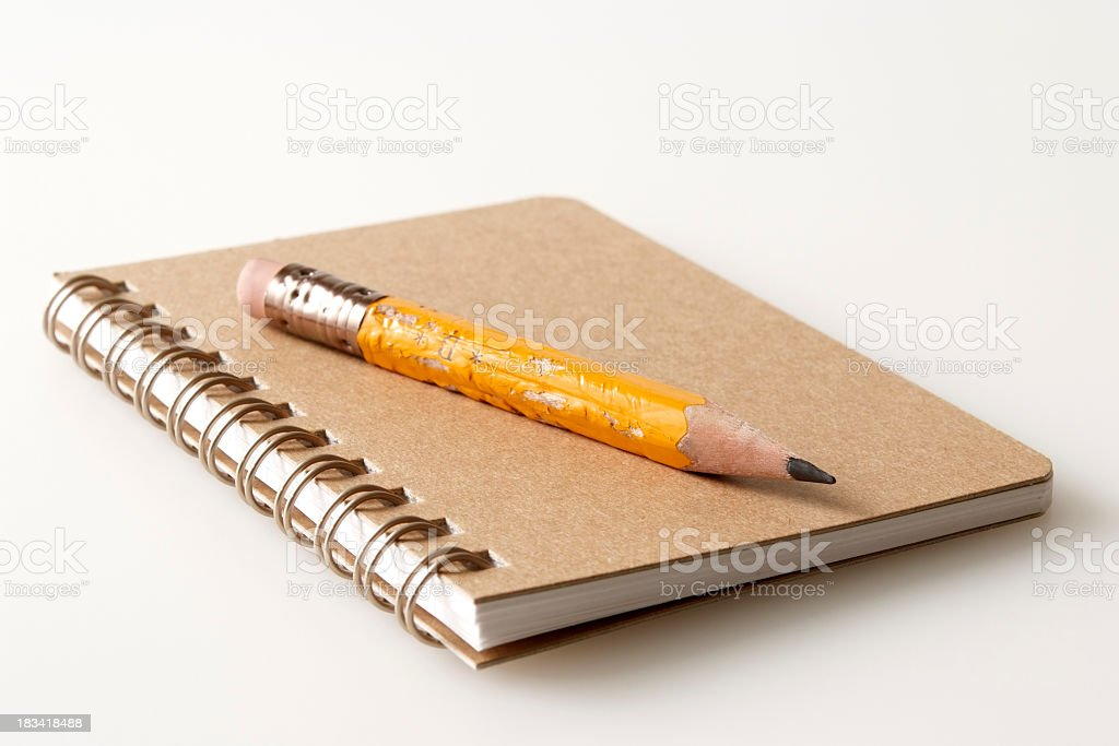 Isolated shot of brown spiral notebook on white background stock photo