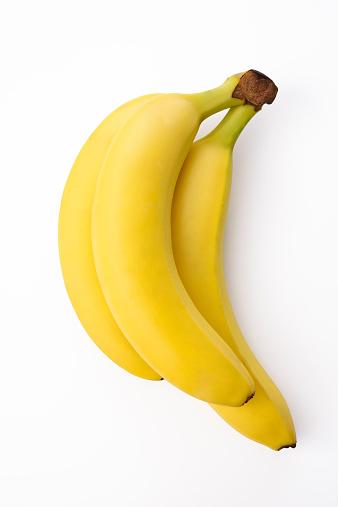 Sleeping and hugging banana couple isolated on white.
