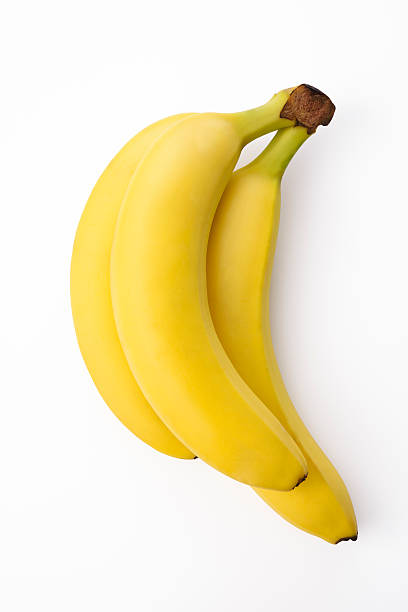 Isolated shot of bunch of bananas on white background bildbanksfoto