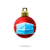 istock Isolated shot of Christmas ball wearing protective medical mask on white background 1281003867