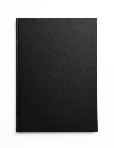 Isolated shot of closed black book on white background stock photo