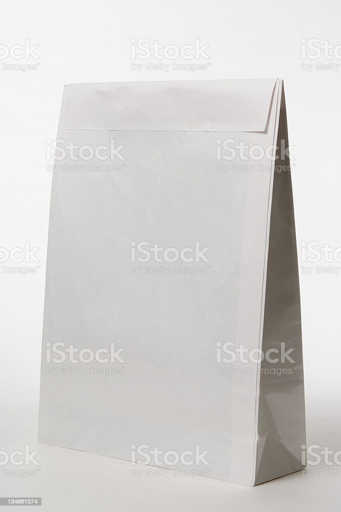 Isolated shot of closed blank paper bag on white background stock photo