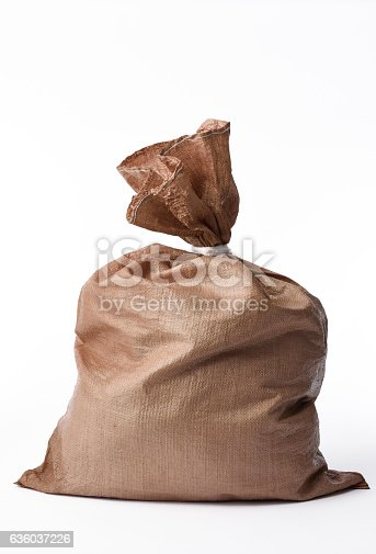 istock Isolated shot of closed brown garbage bag on white background 636037226