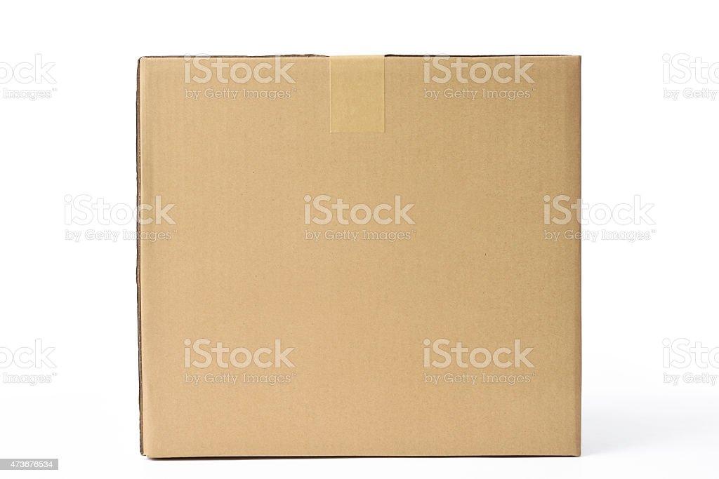 Isolated shot of closed cube cardboard box on white background stock photo