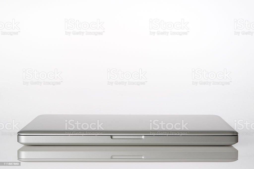 Isolated shot of closed laptop on white background stock photo