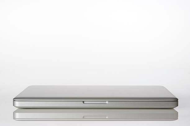 isolated shot of closed laptop on white background - closed stock photos and pictures