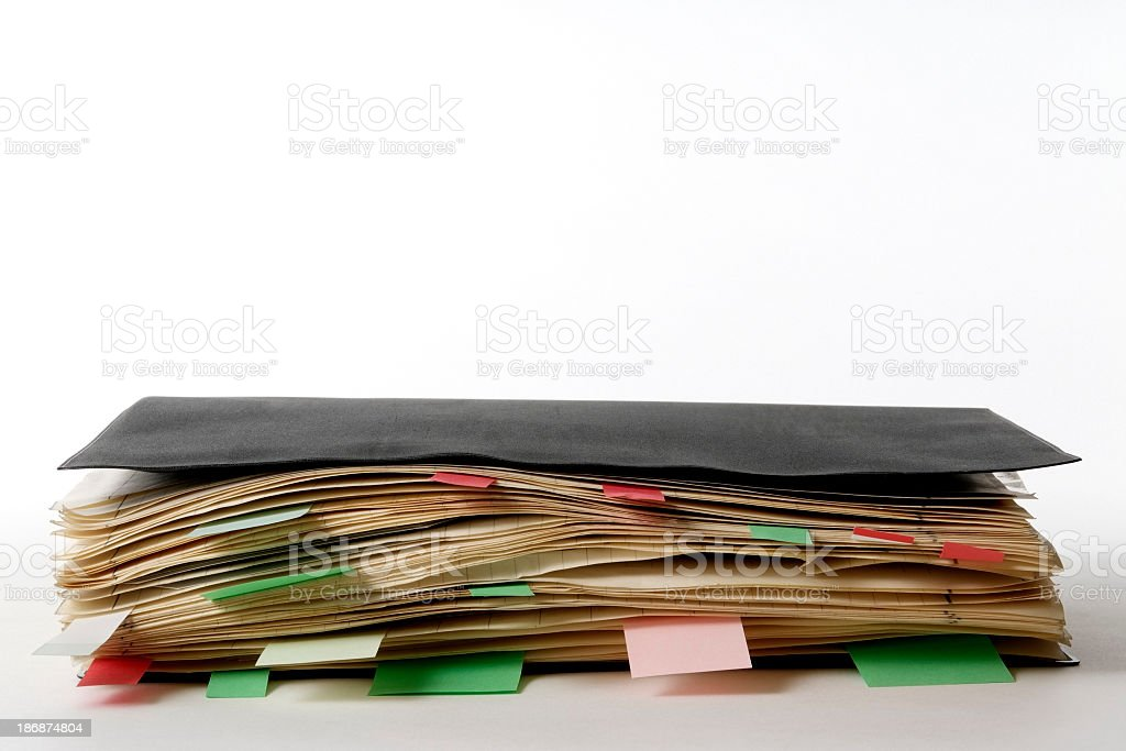 Isolated shot of closed old notebook on white background royalty-free stock photo