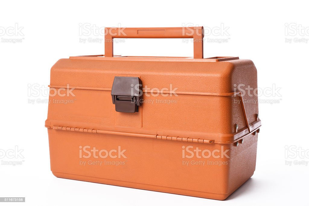 Isolated shot of closed orange tackle box on white background stock photo