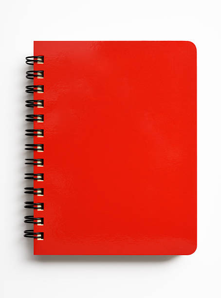 isolated shot of closed red spiral notebook on white background - note pad stock photos and pictures