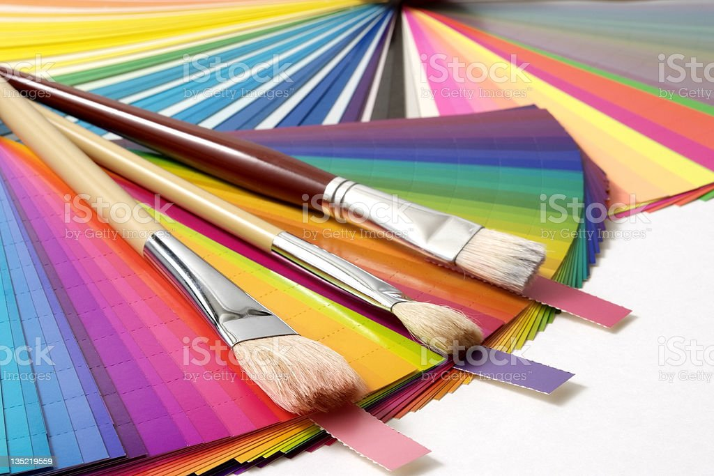 Isolated shot of color swatch and paintbrush on white background royalty-free stock photo
