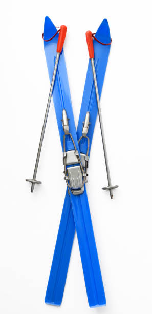 Isolated shot of cross shape vintage blue toy Skis & Poles on white background. stock photo
