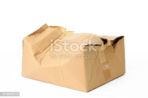 Crushed cardboard box isolated on white background with clipping path.