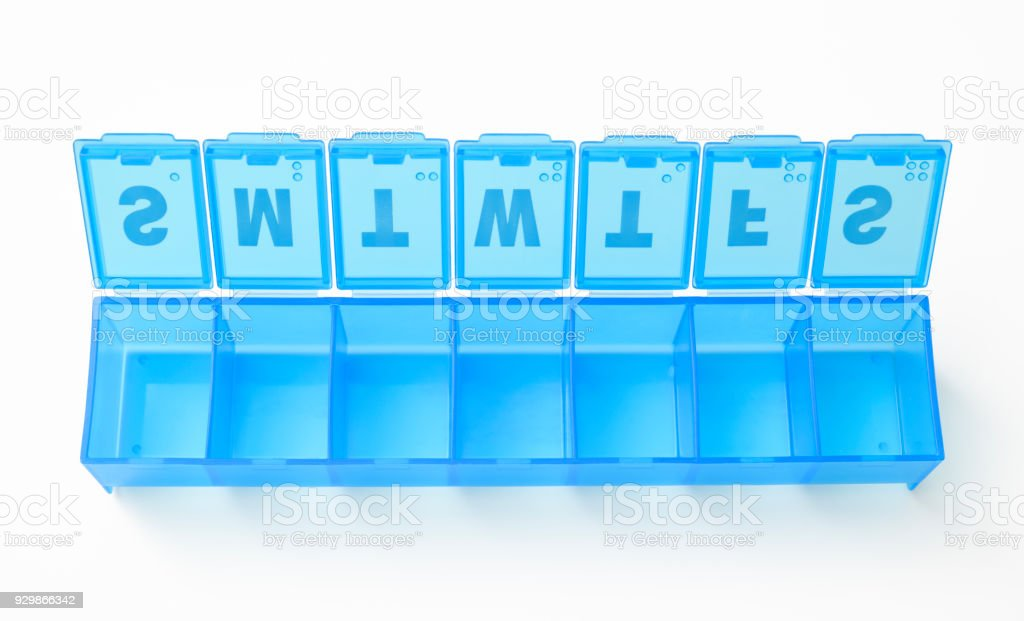 Isolated shot of daily pill box on white background stock photo